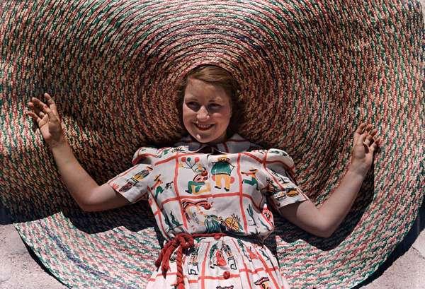 A girl wears a novelty braided Texas straw hat, Texas, 1939