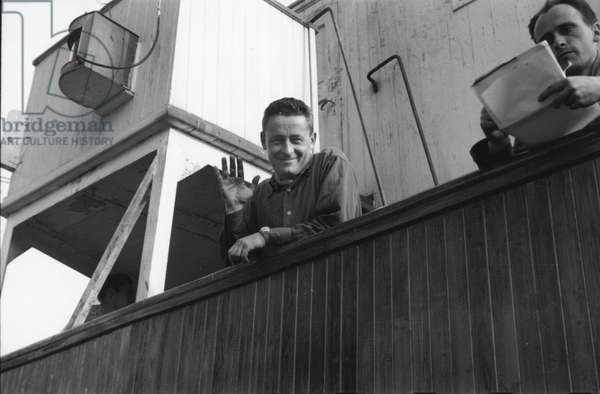 The day before the departure of the first French polar expedition to Greenland, Paul-Emile Victor on the boat le Force, Rouen, France, May 1948 (b/w photo)