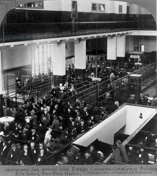 ELLIS ISLAND: IMMIGRANTS The Great Hall at Ellis Island in New York Harbor, 1904.