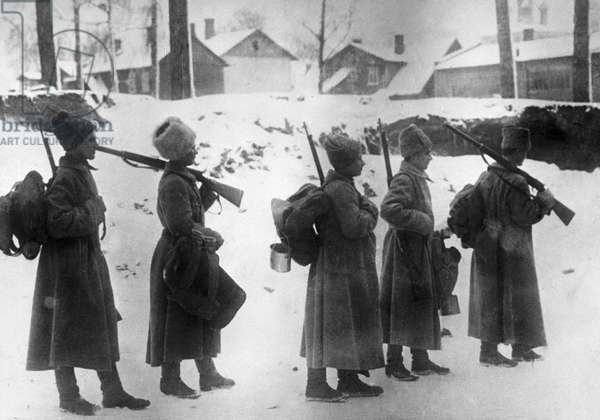 Soldiers leave the front line during the World War I, 1st March, 1918 (b/w photo)