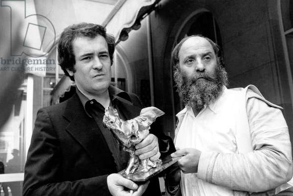 Bernardo Bertolucci Receiving Raoul Levy Prize From French Sculptor Cesar For his Film L' Ultimo Tango in Parigi May 4, 1973 (b/w photo)