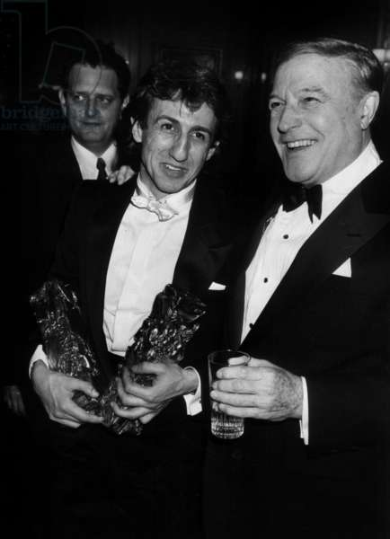 Actor Richard Anconina Recompels Two Cesars for Best Supporting Role In The Film Tchao Pantin And Best Hope Here In Company And Felicite By Gene Kelly In The Nights Of Cesars In The Empire On March 5, 1984 (b/w photo)