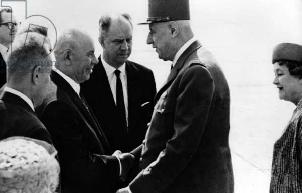 General de Gaulle and his wife Yvonne greeted by Nikolai Podgorny, Chairman of the Presidium of the Supreme Soviet of the Soviet Union, at the Moscow Aerodrome, 20 June 1966 (b/w photo)
