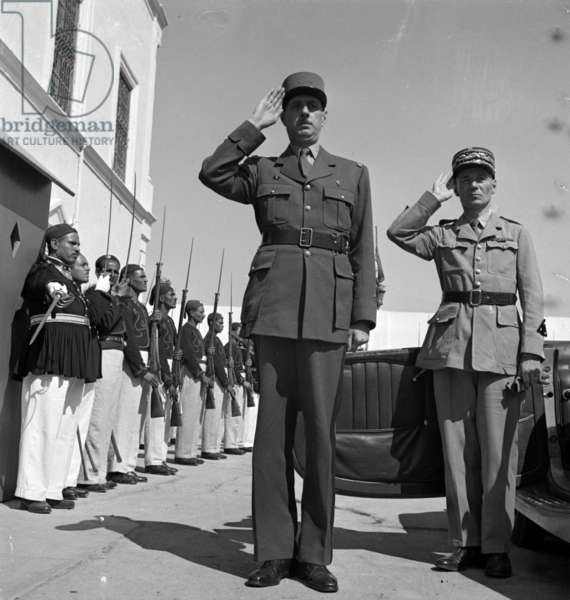 Carthage, Tunisia. General de Gaulle, with General Mast, saluting at the summer palace of the bey of Tunis 19430101,