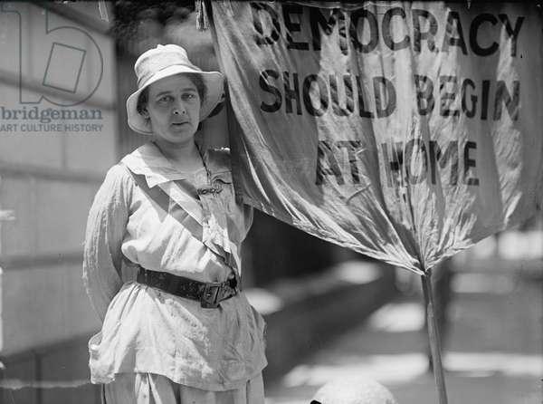 Suffragist outside the White House demanding passage of the 19th Amendment, 1917 (b/w photo)
