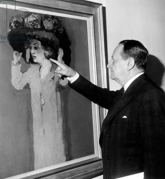 French Minister of Cultural Affairs Andre Malraux Watching Painting in Art Exhibition, Paris, October 13, 1967 (b/w photo)