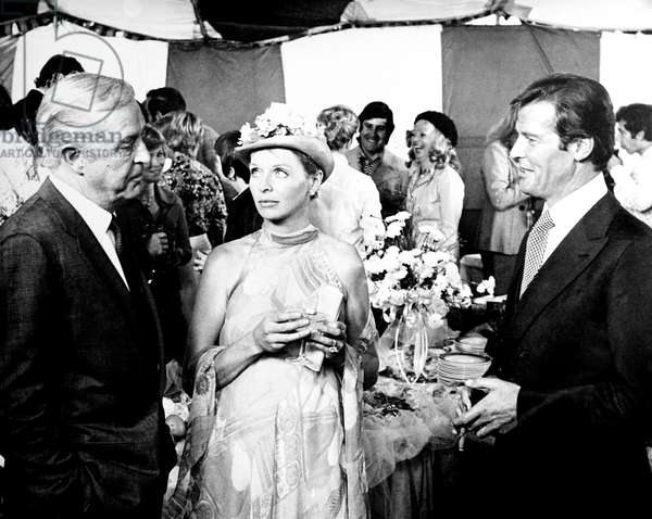 GOLD, from left, Ray Milland, Susannah York, Roger Moore, 1974
