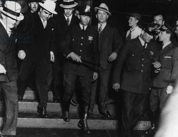 ALPHONSE CAPONE (1899-1947) American gangster. Capone (at left, in white hat) leaving the Chicago courthouse after being convicted for tax evasion and sentenced to prison, 1931.