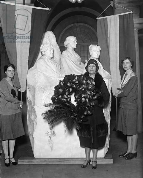 WOMEN'S RIGHTS MEMORIAL Members of the National Council of the Woman's Party honor the birthday of Susan B. Anthony by placing a wreath on a statue in the U.S. Capitol, 15 February 1929.