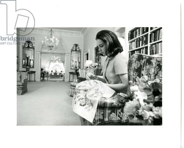 Julie Nixon Eisenhower working on needlepoint in the family quarters on the second floor of the White House, March 1970 (b/w photo)