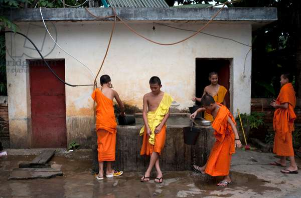 Monks at a monastery cleaning up, Southern China, (photo)