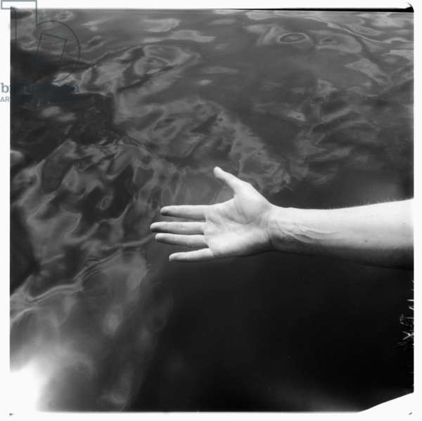 Image of womans hand over the sea, Greece, late early 1950's