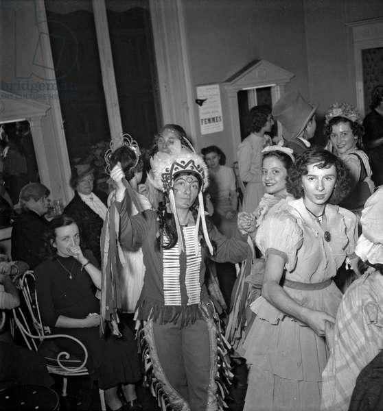 The dressmaker's apprentices celebrating the Saint Catherine at Maud et Nano's, Paris, November 14, 1949 (b/w photo)