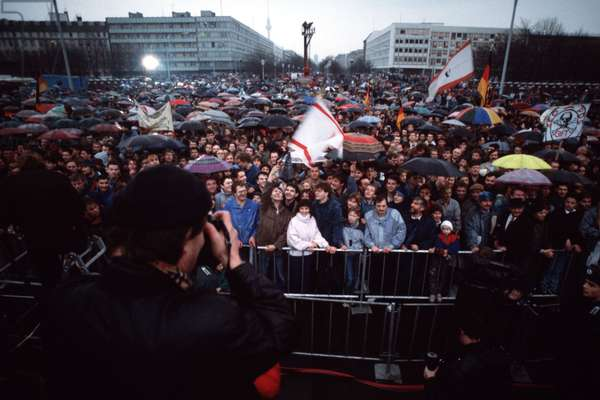 East Germans brave the weather for the official opening of the Brandenburg Gate. Dec. 22 1989