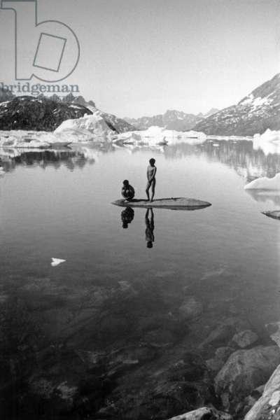 Inuits bathing in a lake, during polar expedition in Greenland, Kangerdlugssuatsiak, Autumn, 1936 (b/w photo)