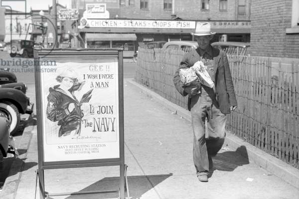 Migrant fruit worker from Arkansas walking by the post office, Benton Harbor, Michigan, 1940 (b/w photo)