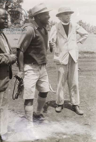 Pro-government Kikuyu and a Catholic priest, 1953 (b/w photo) [1995/076/7/8/1.33]