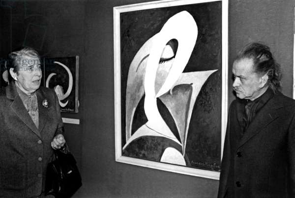 Mrs Picabia and Painter Georges Mathieu at Picabia Exhibition in Paris November 28, 1980 (b/w photo)