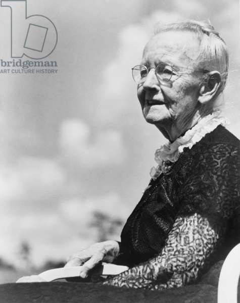 Grandma Moses, born as Anna Mary Robertson (1860-1961), began painting in her seventies and achieved acclaim as a folk painter. c. 1950 at age 90