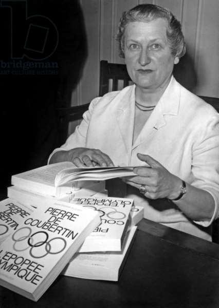 """Marie Therese Eyquem Dedicating Her Book """"Pierre De Coubertin L'Epopee Olympique"""" After receiving the Sports Literature Award offered by the Ministry of Youth and Sports on June 7, 1966 (b/w photo)"""
