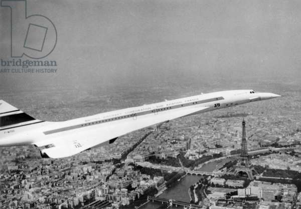 """French Supersonic Plane """"Concorde 001"""" Flighing Over The Eiffel Tower during 28Th Le Bourget Air Fair June 11, 1969 (b/w photo)"""