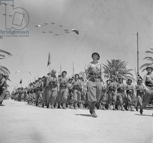 French Troops Passing Reviewing Stand in Allied Victory Parade along Avenue Gambetta as American Planes Fly Overhead in Show of Allied Might, Tunis, Tunisia, Marjorie Collins for Office of War Information, May 20, 1943
