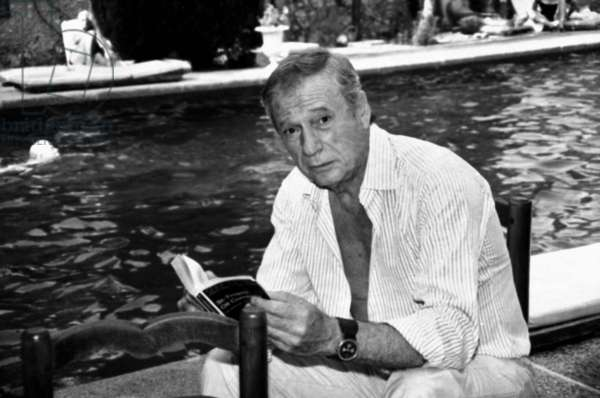 Yves Montand on Holiday in Saint-Paul-De-Vence, France, on July 25, 1983 (b/w photo)
