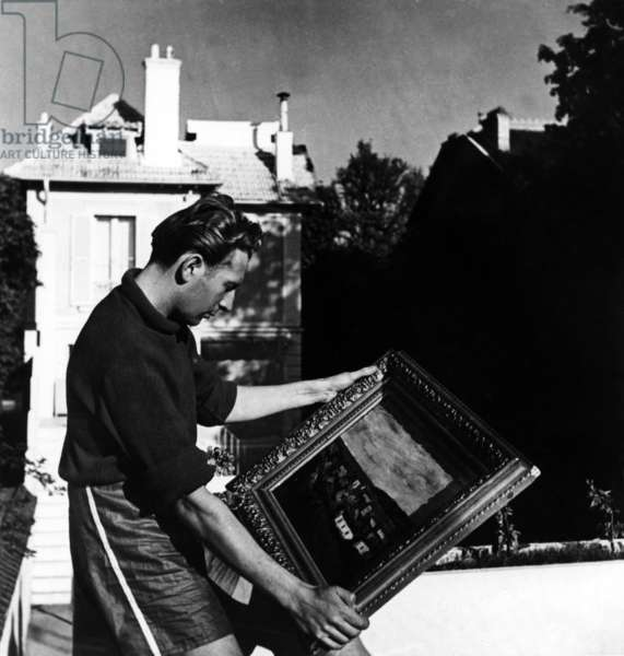 French Singer Charles Trenet Outside his House Witha Painting in September 1946 (b/w photo)
