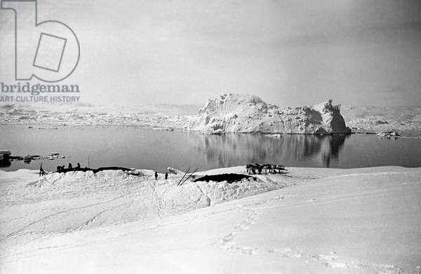 Shared hut of inuit family, fjord of Kangerdlugssuatsiak, Greenland, 1936-1937 (b/w photo)