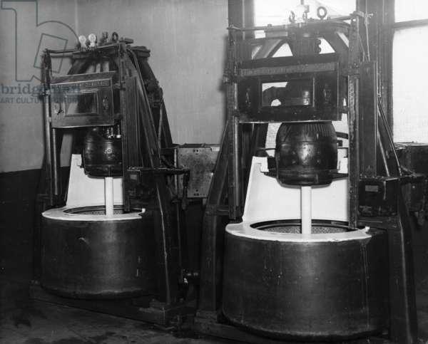 ELLIS ISLAND, c.1940 Laundry and equipment facilities at Ellis Island. Photograph, c.1940.