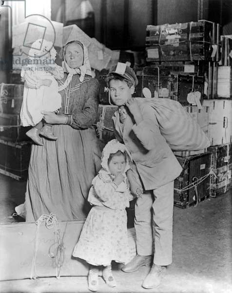 HINE: ELLIS ISLAND, 1905 An immigrant family at Ellis Island. Photograph by Lewis W. Hine, c.1905.