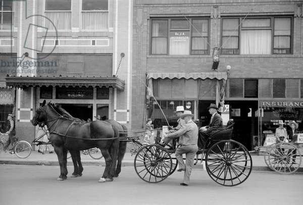 Horse and Buggy on a Main Street, Billings, Montana, USA, Arthur Rothstein for Farm Security Administration (FSA), August 1939