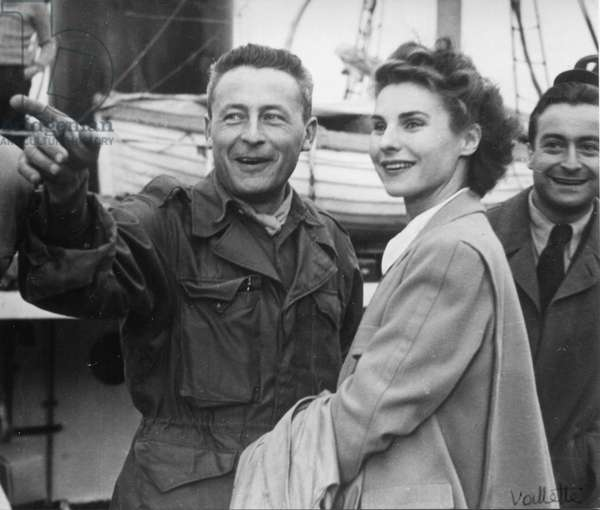 The day before the departure of the first French polar expedition to Greenland, from g to d: Paul-Emile Victor, his wife Éliane, Yves Vallette, Rouen, France, May 1948 (b/w photo)