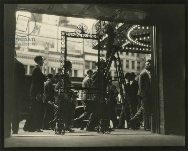 View out from doorway at people on Broadway between 46th and 47th Street, USA, 1925 (gelatin silver photo)