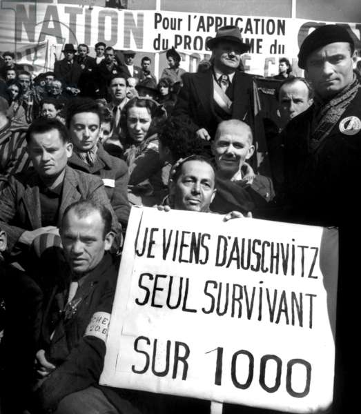 The Surviving of The Concentration and Extermination Camp of Auschwitz Marching For The 1St Day of May, 1945, in Paris (b/w photo)
