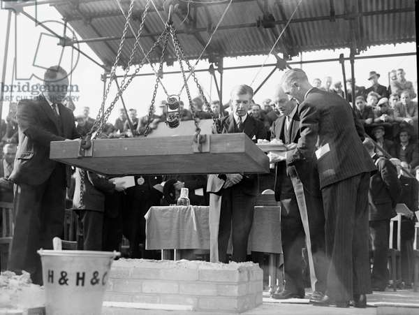 Clement Attlee (Prime Minister) laying the foundation stone of the South Bank Concert Hall for 1951 Exhibition London. Now the Festival Hall, 1949 (b/w photo)