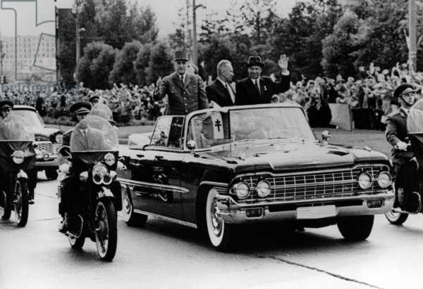 General de Gaulle, Nikolai Podgorny, Chairman of the Presidium of the Supreme Soviet of the Soviet Union, and Alexei Kosygin leave the Moscow Aerodrome, 20 June 1966 (b/w photo)