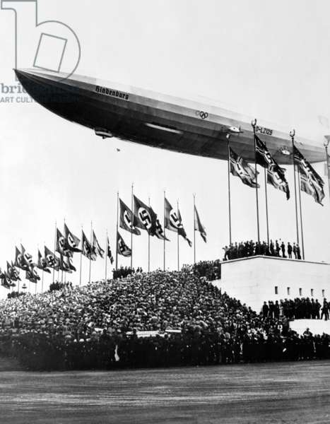 The Hindenburg, flying low in salute of the Nazi hosts of the Nuremberg Congress. Shortly afterward it departed for the United States. October 20, 1936