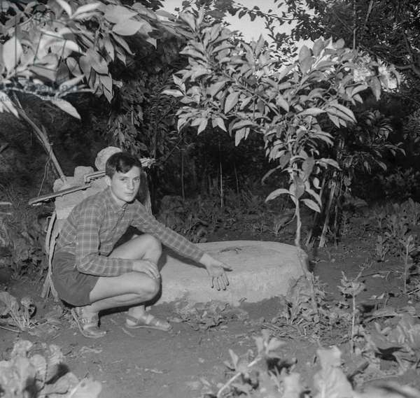 Brigitte Bardot's suicide attempt : the young Jean Louis Bournous (13) showing the place where he found Bardot (on the edge of a well) who was at a friend's home near Menton, French Riviera, September 30, 1960 (b/w photo)