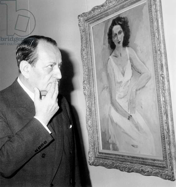 French Minister of Cultural Affairs Watching Painting in Art Exhibition (b/w photo)