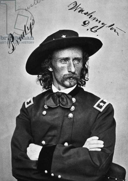 GEORGE CUSTER (1839-1876) American army officer. Photographed, 1865, in the uniform of a major general by Mathew Brady.