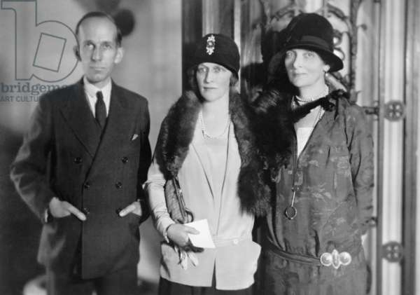 Lady Astor (center), American born British peeress, visits with Canadian minister Vincent Massey and his wife in Washington, D.C. in 1928. When elected in 1919, she was the first woman to sit in the British House of Commons
