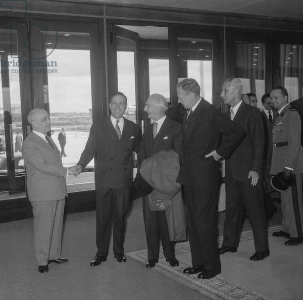 At Orly airport in Paris, Michel Debre and Maurice Couve de Murville welcoming Amintore Fanfani, Italian head of state, and Antonio Segni, Italian minister of Foreign affairs, September 3, 1960 (b/w photo)