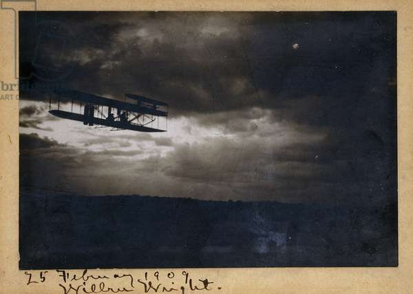 Wilbur Wright in Flight, with autograph signature 'Wilbur Wright' and date '25 February 1909', c.1909 (gelatin silver print, on mount, ink)