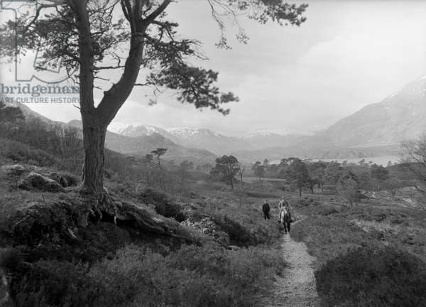 W. Finlayson, stalker and resident of Alltbeithe with postman, Glen Affric (b/w photo)