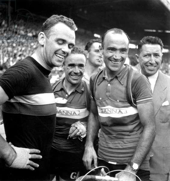 Arrival of Tour De France, July 26, 1953 in Paris : Rik Van Steenbergen, Mario Baroni and Fiorenzo Magni (b/w photo)