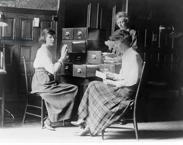 Three women work at the card index files at the headquarters of the National Woman's Party, Washington D.C., pub. c.1920 (b/w photo)