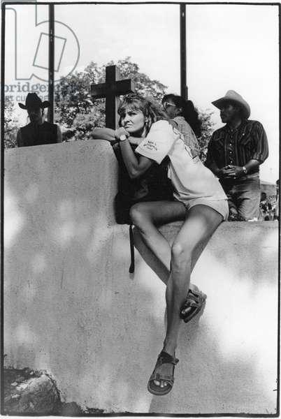 Long-legged woman, USA (b/w photo)
