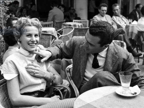 Ornella Vanoni and Livio De Simone sitting at the cafe 'Vuotto' in the square, Capri, Italy, April 1952 (b/w photo)