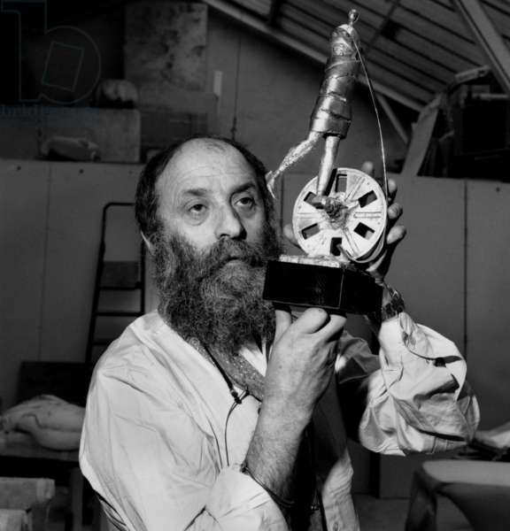 Sculptor Cesar With his Project of Trophy For The Cesars (French Movie Prize) on March 23, 1976 (b/w photo)